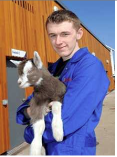 Animal care student with a goat