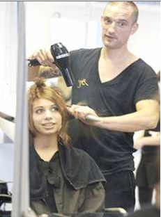 Hairdressing student styling hair
