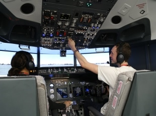 Engineering students in flight simulator