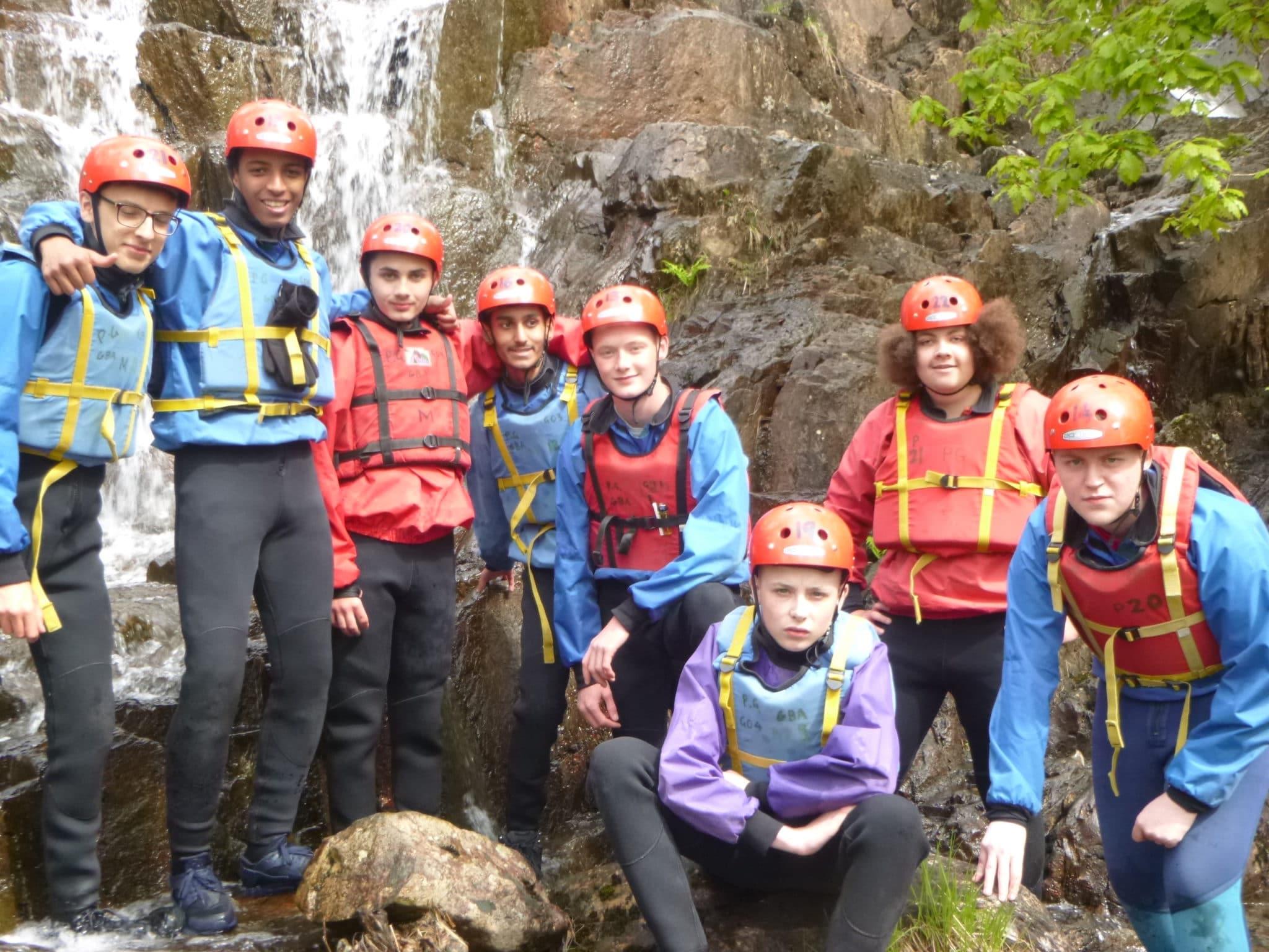 Students at a waterfall