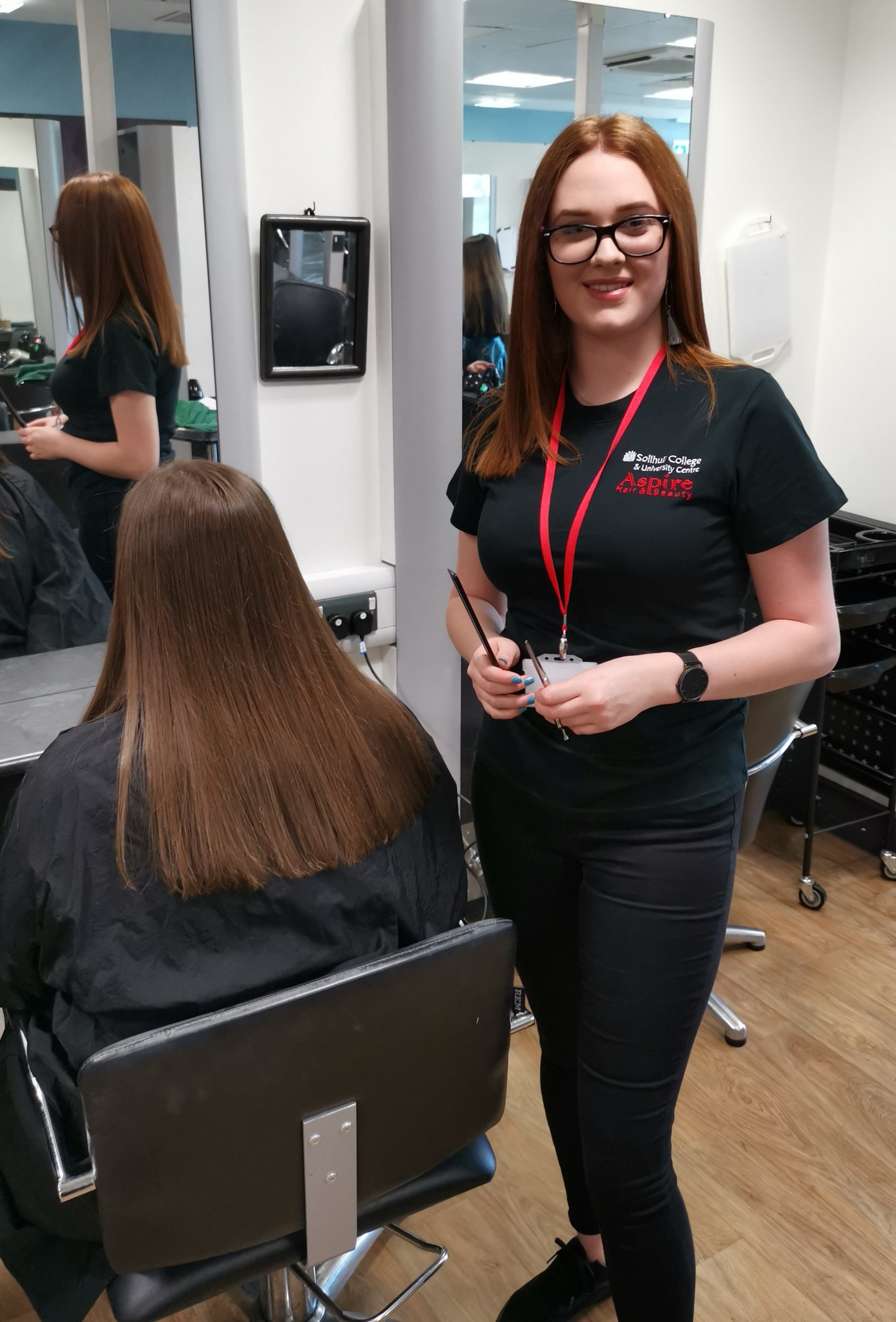 Cliodhna stands in salon