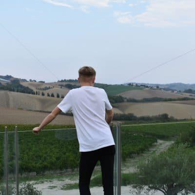 boy looking over fields