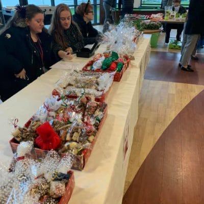 students selling dog treats