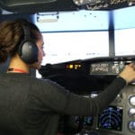 a female student in the flight simulator