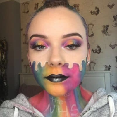 Liliana Smith with rainbow painted face and the words thank you NHS on her neck