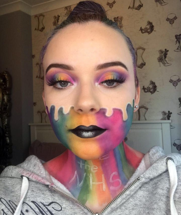 Liliana Smith with rainbow makeup and the words thank you NHS on her neck.
