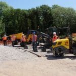 Workmen stood by plant equipment