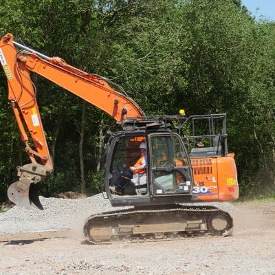 workman in machinery digger